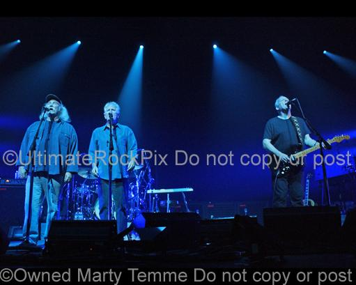 Photos of David Crosby, Graham Nash and David Gilmour of Pink Floyd Performing Together in Concert by Marty Temme