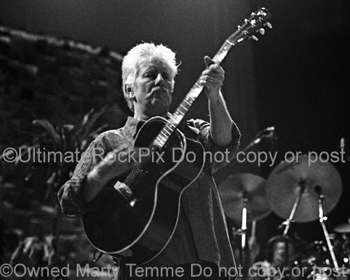 Photo of Graham Nash of Crosby, Stills, Nash and Young in concert by Marty Temme