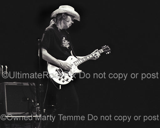 Black and white photo of Neil Young in concert by Marty Temme