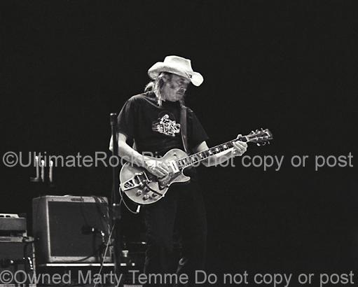 Black and White Photos of Neil Young of CSNY Performing in Concert by Marty Temme