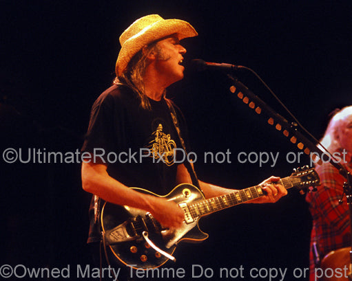 Photo of Neil Young playing a Gibson Goldtop in concert by Marty Temme