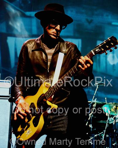Photos of Guitar Player Mike Dimkich of The Cult and Bad Religion Playing a Gibson Les Paul Junior in Concert by Marty Temme