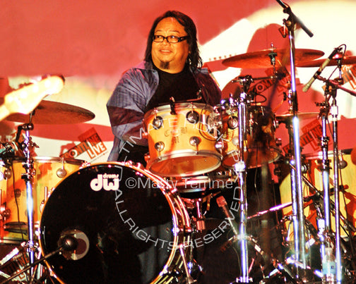 Photo of drummer Curt Bisquera in concert by Marty Temme