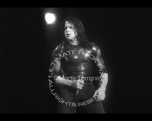 Black and white photo of Glenn Danzig during a concert in 1995 by Marty Temme