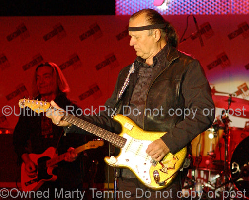 Photo of Dick Dale playing a Stratocaster in concert by Marty Temme