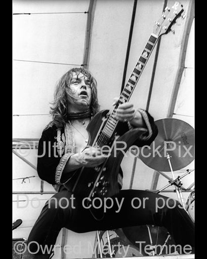 Photo of Rick Derringer of Derringer in concert in 1977 by Marty Temme