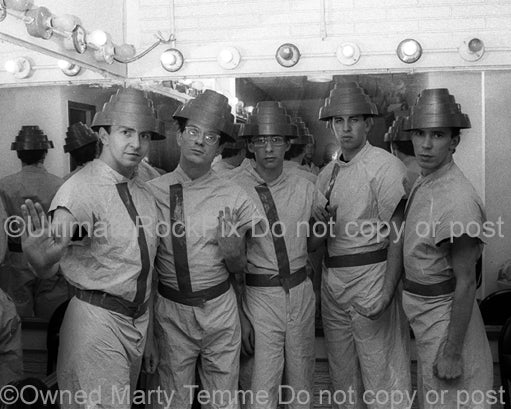 Black and white photo of the band Devo backstage in 1980 by Marty Temme