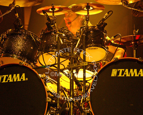 Photo of drummer Dave Mackintosh of DragonForce in concert by Marty Temme