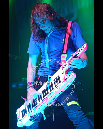 Photo of keyboardist Vadim Pruzhanov of DragonForce in concert by Marty Temme