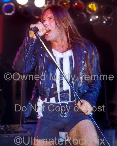 Photo of Bruce Dickinson of Iron Maiden singing onstage in 1994 in Los Angeles, California by Marty Temme