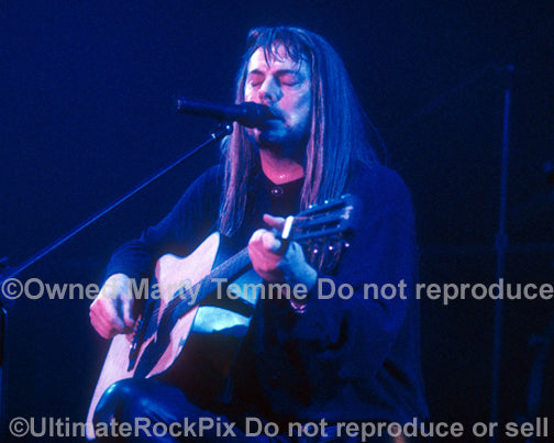 Photo of Don Dokken playing acoustic guitar in concert in 1995 by Marty Temme