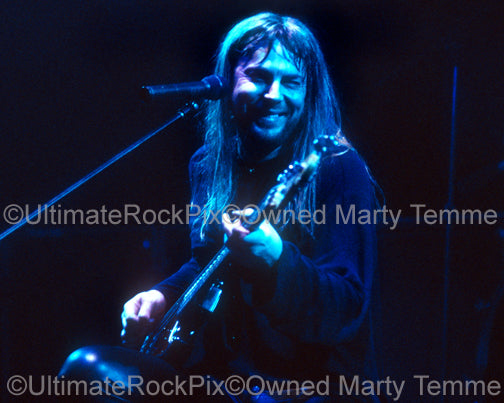 Photo of Don Dokken singing and playing bass in concert in 1995 by Marty Temme