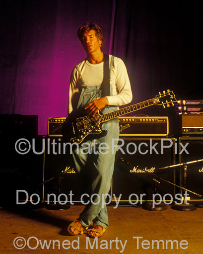 Photo of George Lynch with his ESP guitar during a photo shoot in 1995 by Marty Temme
