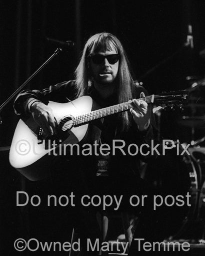Black and white photo of Don Dokken playing guitar in concert in 1995 by Marty Temme