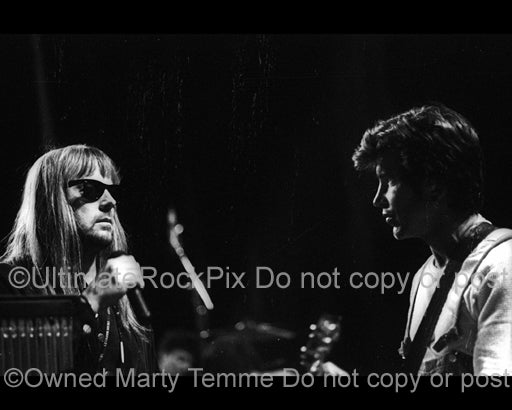 Black and white photo of George Lynch and Don Dokken in concert in 1995