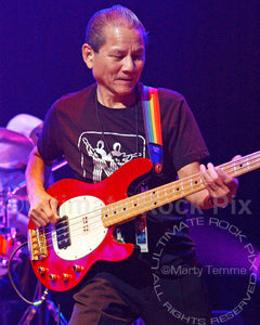 Photo of bass player Phil Chen in concert in 2009 by Marty Temme