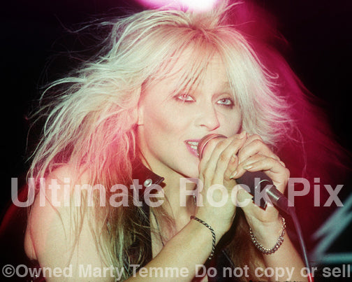 Photo of Doro Pesch in concert in 1990 by Marty Temme