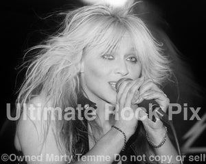 Black and white photo of Doro Pesch in concert in 1990 by Marty Temme