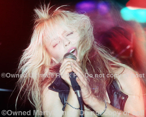 Photo of singer Doro Pesch in concert in 1990 by Marty Temme