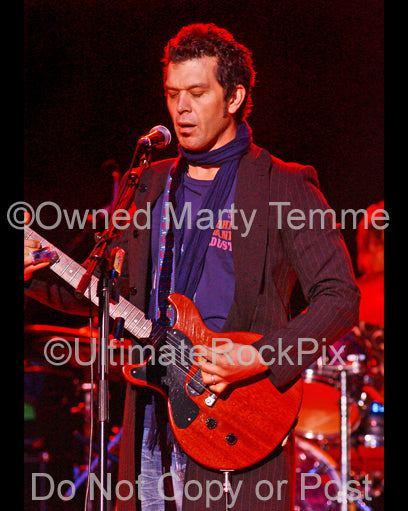 Photo of Doyle Bramhall II playing a Les Paul Junior in concert in 2008 by Marty Temme