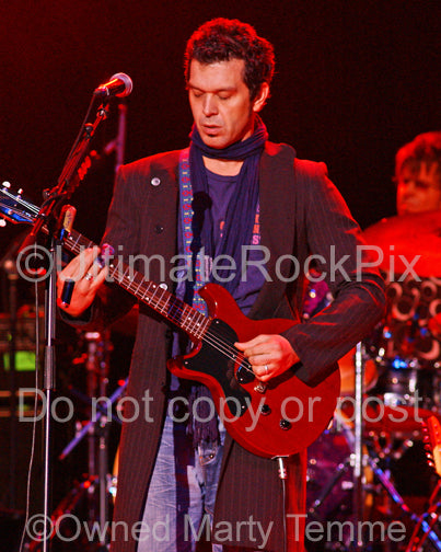Photo of Doyle Bramhall II playing a left-handed Les Paul Junior in concert by Marty Temme