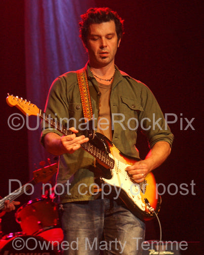 Photo of guitarist Doyle Bramhall II playing a Stratocaster in concert by photographer Marty Temme