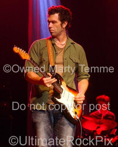 Photos of Doyle Bramhall II Playing Guitar in Concert by Photographer Marty Temme
