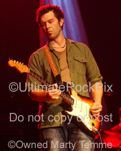 Photos of Doyle Bramhall II playing a Fender Stratocaster in Concert by Photographer Marty Temme
