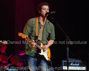 Photo of Doyle Bramhall II playing a Stratocaster in 2010 by Marty Temme