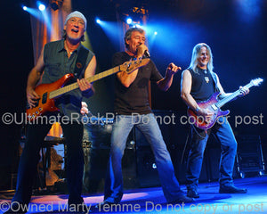 Photo of Roger Glover, Ian Gillan and Steve Morse of Deep Purple in concert in 2007 by Marty Temme