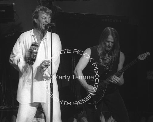 Black and white photo of Ian Gillan and Steve Morse of Deep Purple in concert by Marty Temme