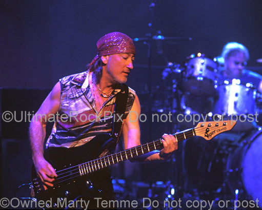Photo of bass player Roger Glover of Deep Purple in concert in 2004 by Marty Temme