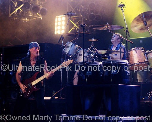 Photo of Roger Glover and Ian Paice of Deep Purple in concert in 2002 by Marty Temme