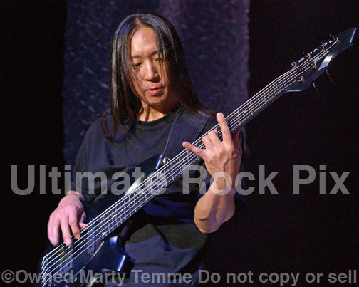Photo of bassist John Myung of Dream Theater in concert in 2009 by Marty Temme
