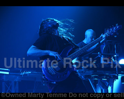 Photo of bassist John Myung of Dream Theater in concert in 2011 by Marty Temme