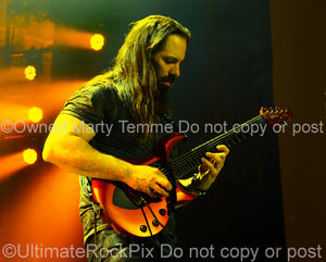 Photo of guitarist John Petrucci of Dream Theater in concert in 2014 by Marty Temme