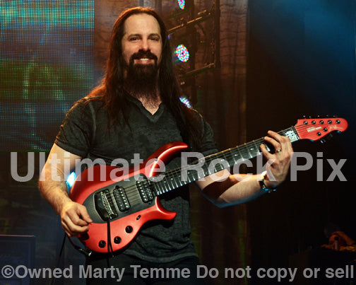 Photo of guitar player John Petrucci of Dream Theater in concert by Marty Temme