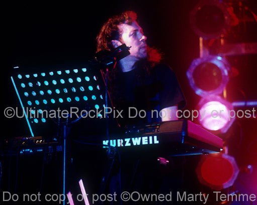 Photo of keyboardist Kevin Moore of Dream Theater in concert in 1994 by Marty Temme