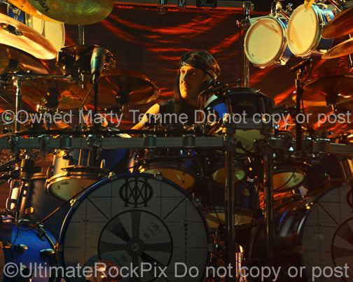Photo of Mike Mangini of Dream Theater in concert in 2014 by Marty Temme
