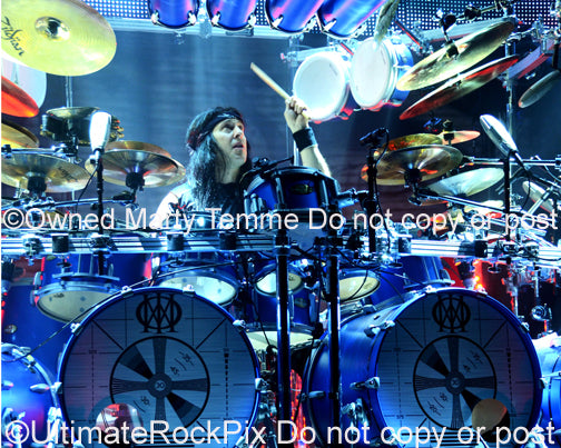 Photo of drummer Mike Mangini of Dream Theater in concert in 2014 by Marty Temme