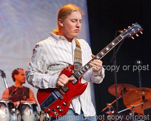 Photos of Derek Trucks of The Allman Brothers Playing Slide Guitar in Concert in 2006 by Marty Temme