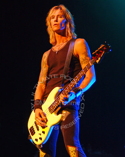 Photo of bass player Duff McKagan of Guns N' Roses in concert by Marty Temme