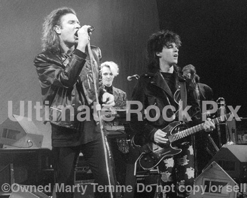Photo of Simon Le Bon and Warren Cuccurullo of Duran Duran in concert in 1989 by Marty Temme