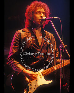 Photo of Bob Dylan playing a Fender Stratocaster in concert in 1980 by Marty Temme