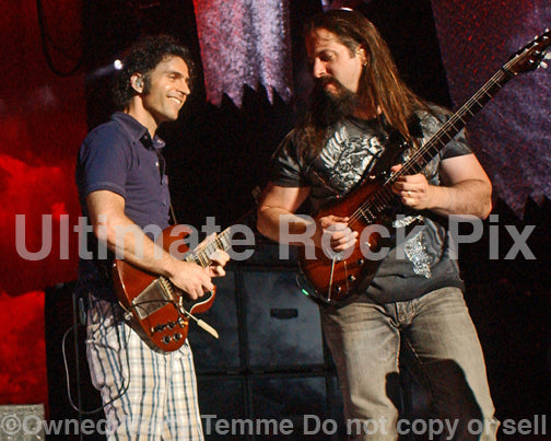 Photo of guitar players Dweezil Zappa and John Petrucci in concert in 2009 by Marty Temme