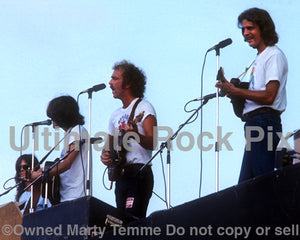 Photo of Randy Meisner, Glenn Frey, Bernie Leadon and Don Felder of The Eagles in concert in 1974 by Marty Temme