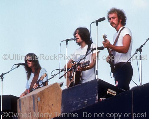 Photos of Randy Meisner, Glenn Frey and Bernie Leadon of The Eagles in Concert in 1974 by Marty Temme