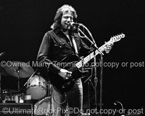 Photo of Don Felder of The Eagles playing a Fender Telecaster in concert in 1980 by Marty Temme