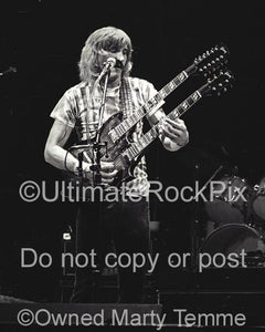 Photos of Guitar Player Joe Walsh of The Eagles Playing a Gibson Doubleneck in Concert in 1980 by Marty Temme