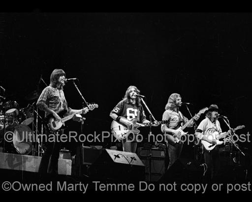 Photos of Randy Meisner, Glenn Frey, Don Felder and Joe Walsh of The Eagles in Concert in 1976 by Marty Temme